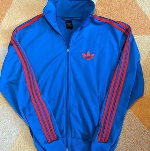 Red and blue Adidas track jacket